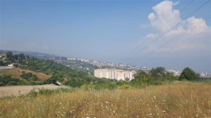 Kent konut üzeri satılık 7.640 m2 imara bitişik tarla